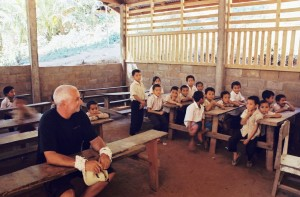 Marty at half finished school at Ban Kok Phu Still has a dirt floor, no eaves, plaster or dividing walls